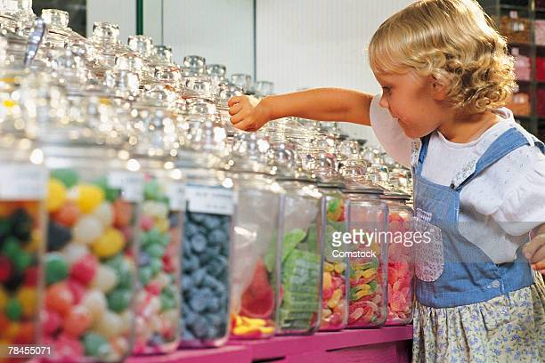 Girl in a candy shop making her selection