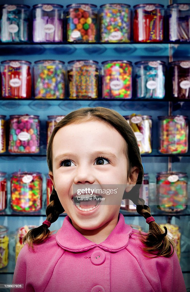 Girl in a candy store : Stock Photo