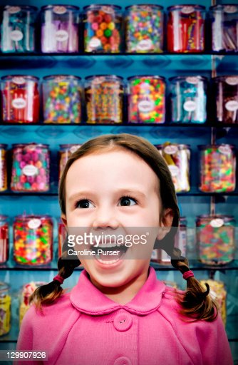 Girl in a candy store : Foto stock