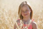 Girl in a field of wheat