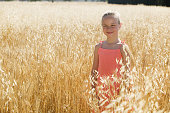 Girl in a field of wheat