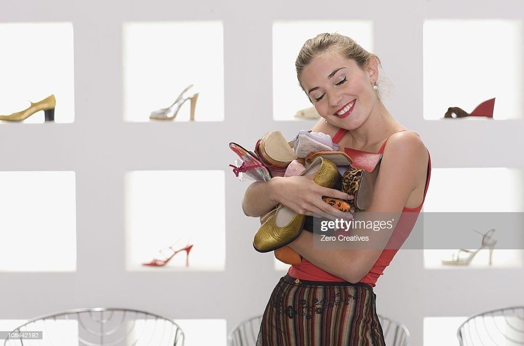 Girl in a shoe shop : Stock Photo
