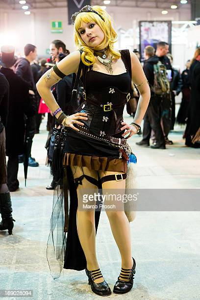 A girl in a steam punk outfit poses for pictures on the second day of the annual WaveGotik Treffen or Wave and Goth Festival on May 18 2013 in...