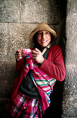 A girl in a stone archway, with an ice-cream - Cuzco