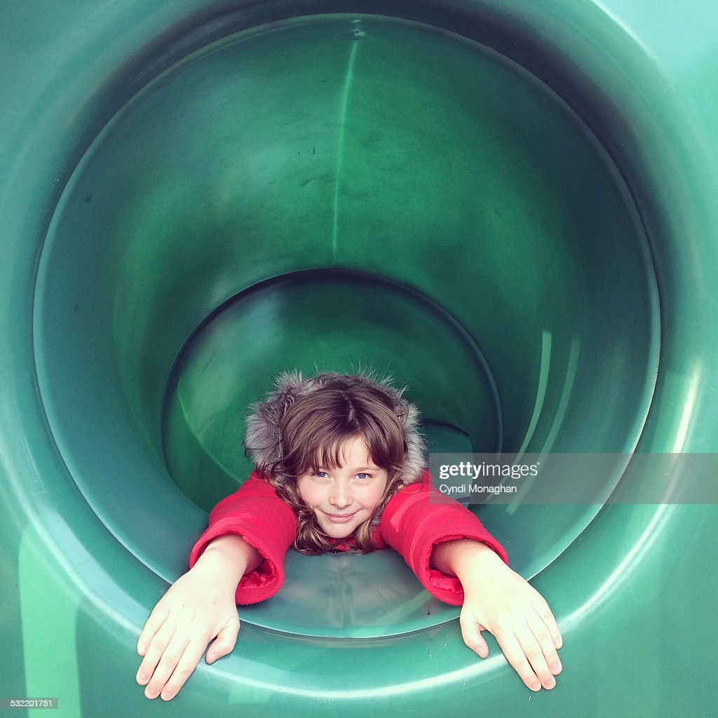 Girl in a tunnel slide
