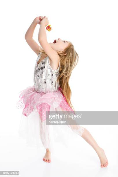 Girl in a tutu singing into a microphone