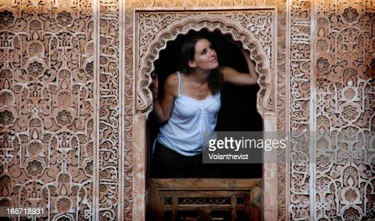 Girl in a window of a Moorish palace in Marrakech