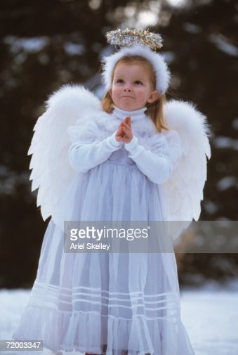 Girl in angel costume outdoors