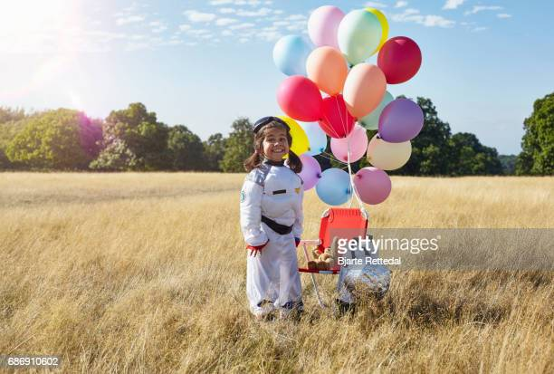 Girl in Astronaut Suit smiling to camera
