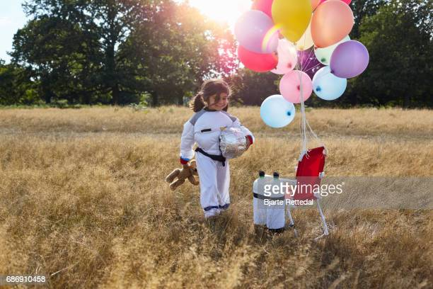 Girl in Astronaut Suit walking to her space ship
