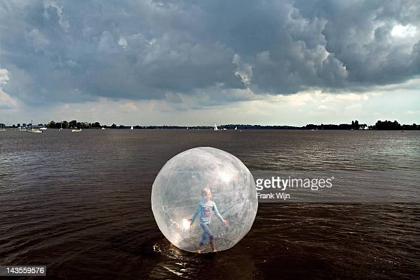 Girl in ball on water