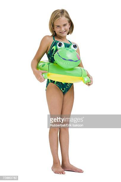 Girl in bathing suit with swim ring
