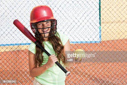 Girl in batting cage