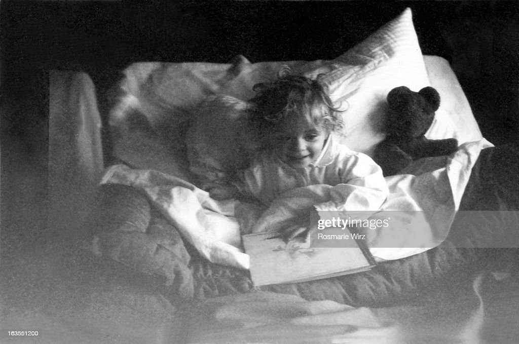 Girl in bed with a cold : Stock Photo