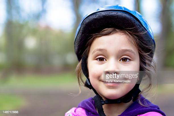 Girl in bicycle hat