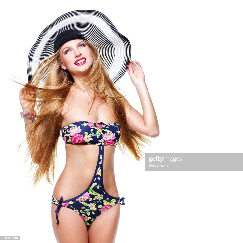 Girl in bikini and summer hat : Stock Photo