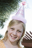 Girl in birthday hat