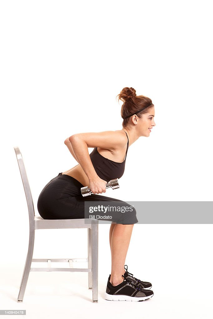Girl in black spandex working out on : Stock Photo