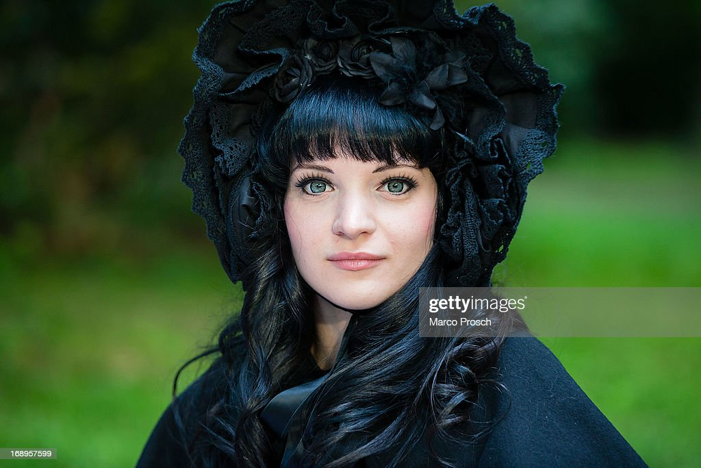 A girl in black Vicotrian clothing attends the traditional park picnic on the first day of the annual Wave-Gotik Treffen, or Wave and Goth Festival, on May 17, 2013 in Leipzig, Germany. The four-day festival, in which elaborate fashion is a must, brings together over 20,000 Wave, Goth and steam punk enthusiasts from all over the world for concerts, readings, films, a Middle Ages market and workshops.