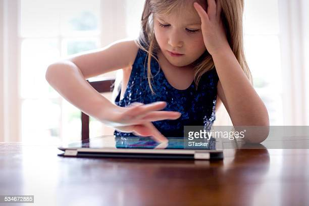 Girl in blue dress with tablet