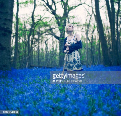 Girl in blue forest : Stock Photo