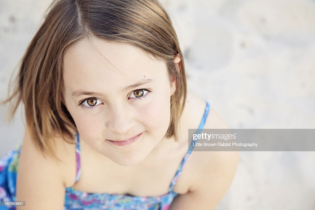 Girl in Blue on Sand : Stock Photo