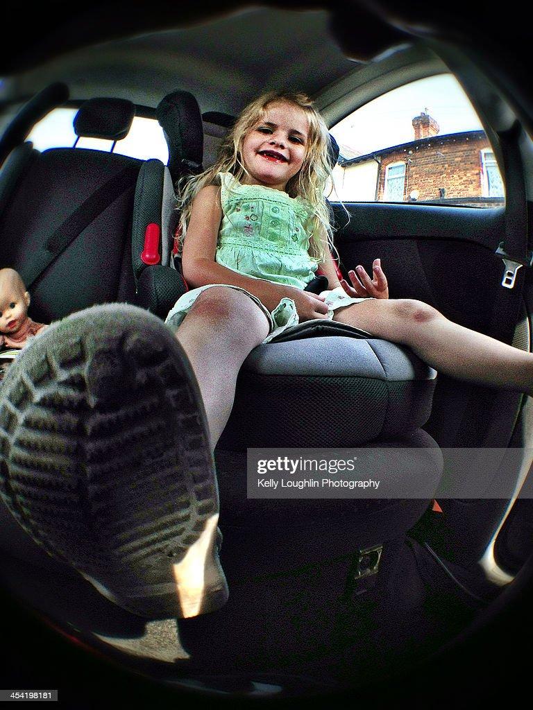 Girl in car seat on journey : Foto de stock