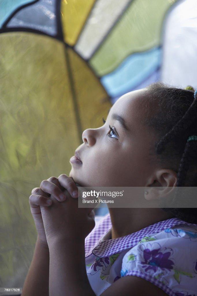 Girl in church praying
