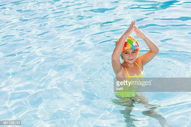 Girl in colorful swim cap