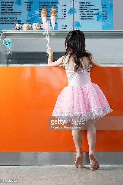 Girl in costume in ice cream store