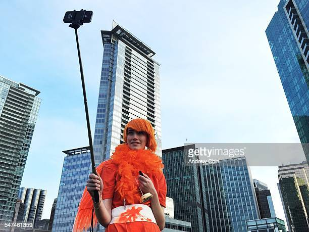A girl in costume takes a selfie against downtown Vancouver buildings on April 4 2015 in Vancouver BC Canada