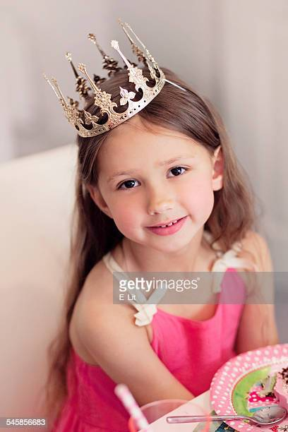Girl (4-5) in crown and with birthday cake