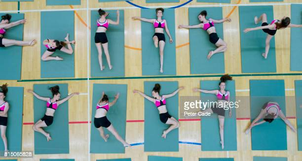 Girl in different positions on exercise mat