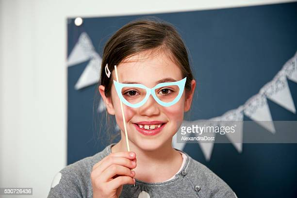 Girl in fancy dress and glasses, Munich, Bavaria, Germany