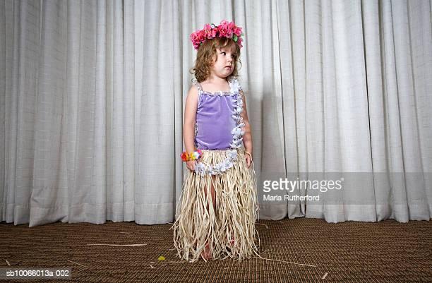 Girl (2-3) in fancy dress costume, looking away