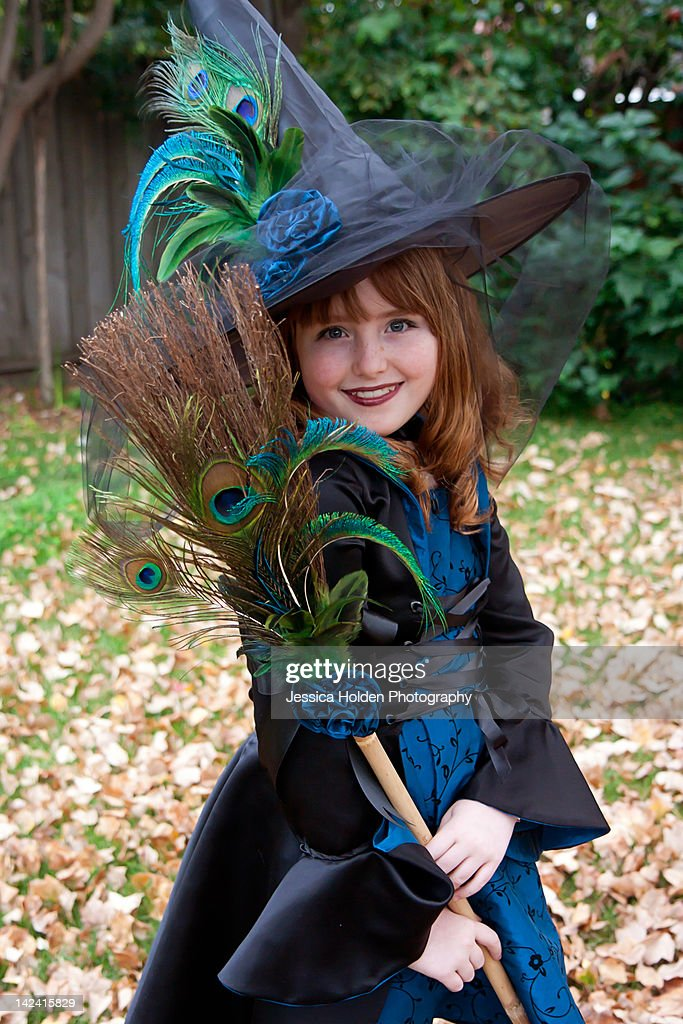 Girl in fancy witch costume : Stock Photo