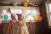 Girl in floral dress dancing