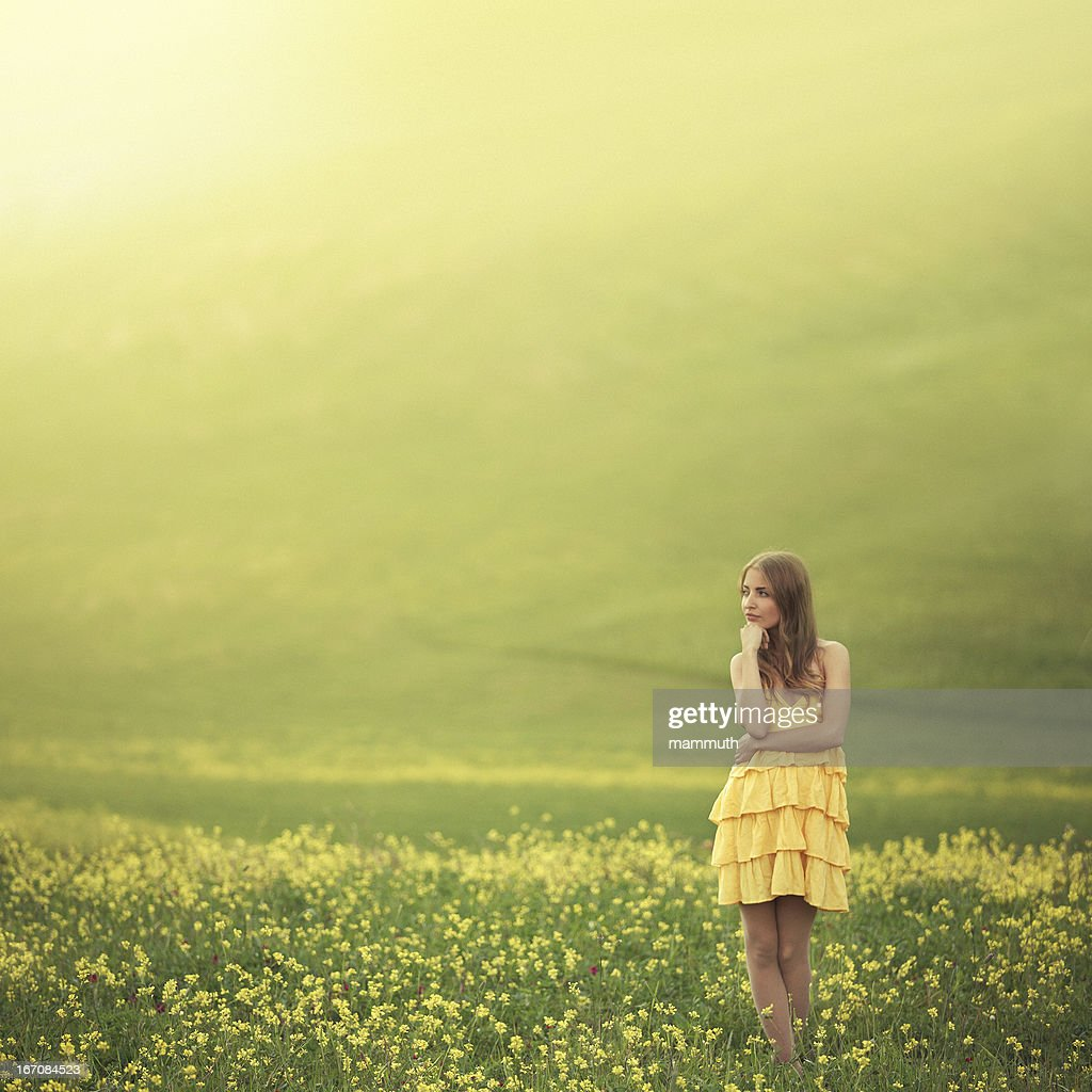 girl in flower covered field : Stock Photo