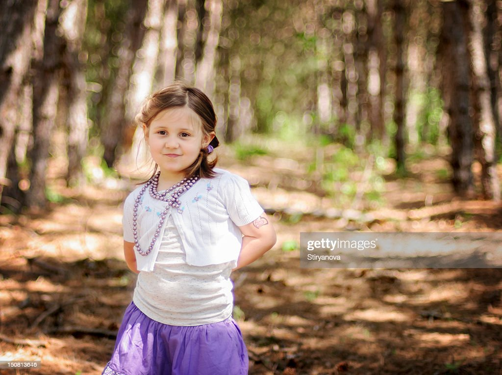 Girl in forest : Stock Photo