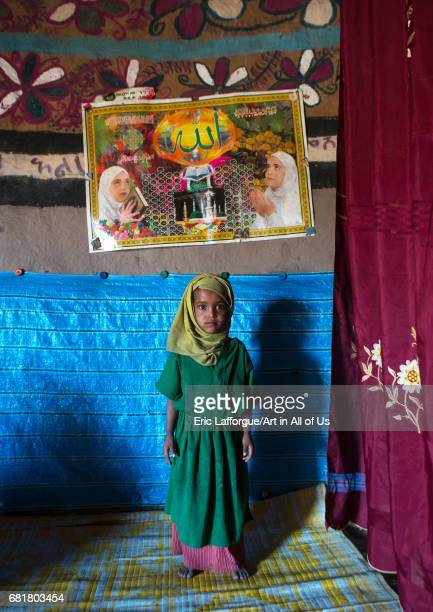Girl in front of a muslim poster inside her house Kembata Alaba Kuito Ethiopia on March 8 2016 in Alaba Kuito Ethiopia