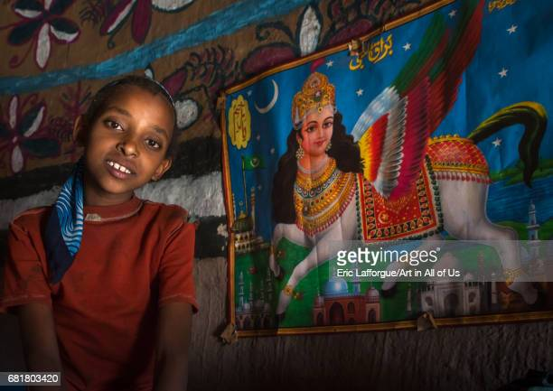 Girl in front of an al buraq winged horse poster inside her house Kembata Alaba Kuito Ethiopia on March 8 2016 in Alaba Kuito Ethiopia