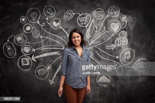 Girl in front of social media icon chalkboard : ストックフォト
