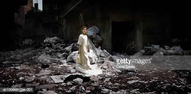 Girl (6-7) in garbage strew alley