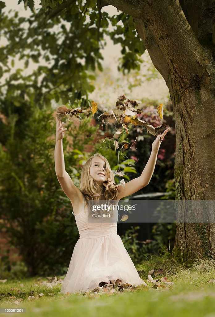 Girl in garden with leaves