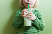 Girl in Green Sipping Green Milkshake