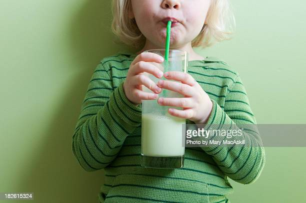 Girl in Green Sipping Green Milkshake