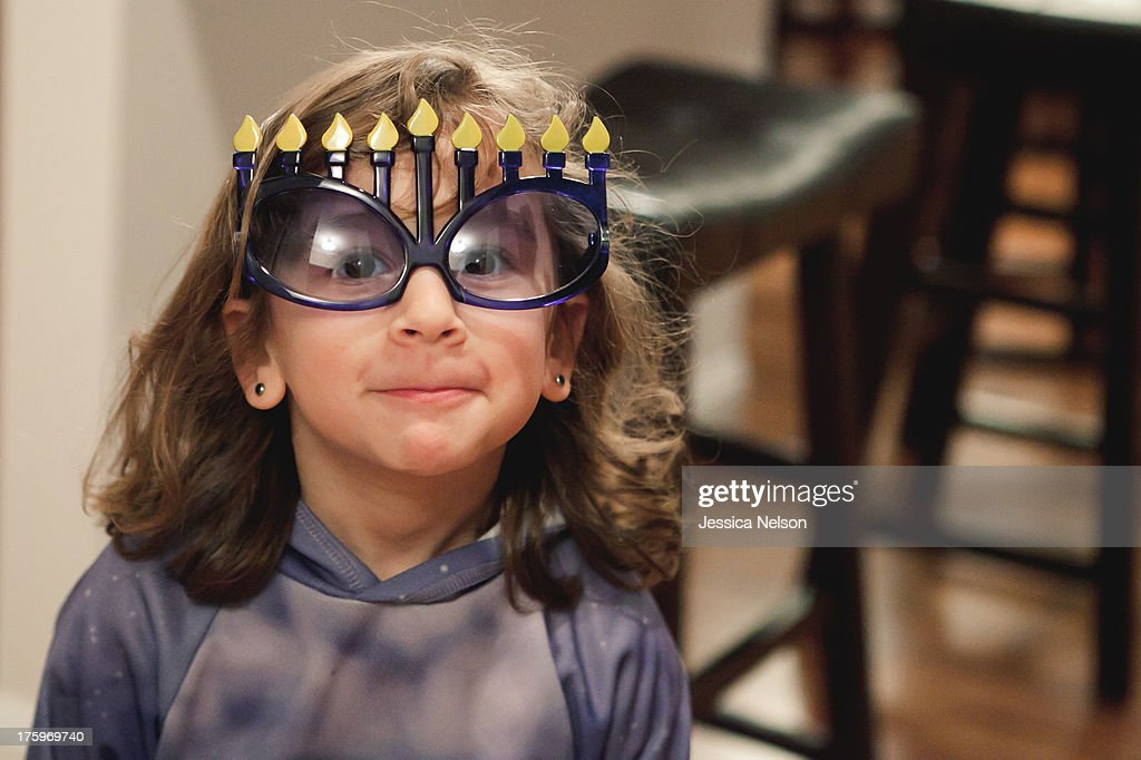 Girl in Hanukkah Glasses