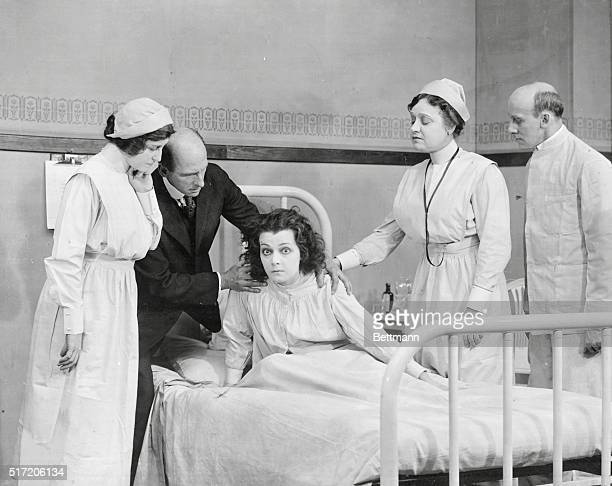 Girl in hospital bed surrounded by doctors and nurses Movie still scene from On Trial 1917