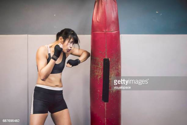 Girl in Martial Arts Practice, Punching Bag