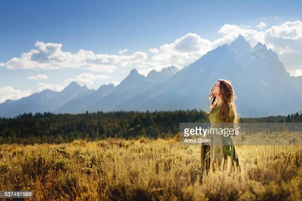 Girl in medieval dress with mountain range